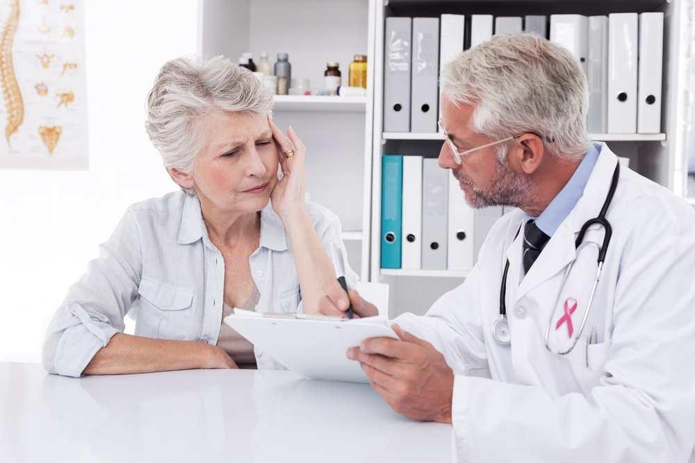 female senior patient visiting a doctor discussing medication problems-1.jpeg