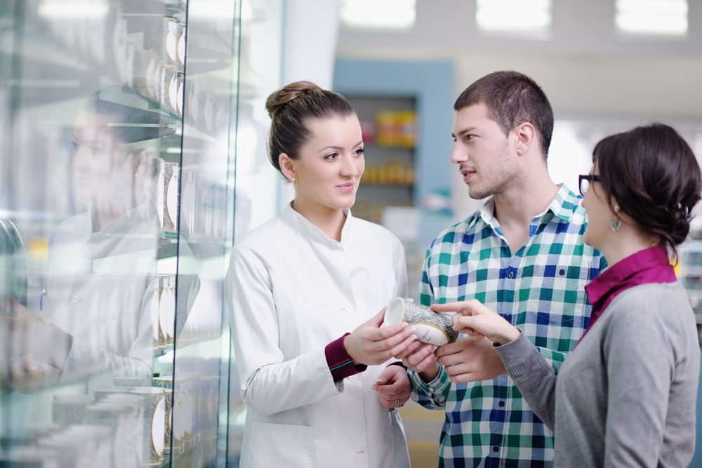 clincal pharmacist suggesting medication to patient in pharmacy drugstore.jpeg